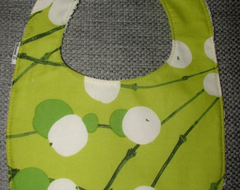 Lime green Lumimarja bib for a girl, Marimekko cotton fabric, Finland,