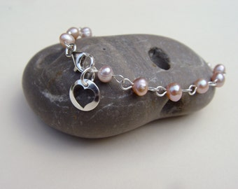 Sterling silver bracelet with pink natural pearls