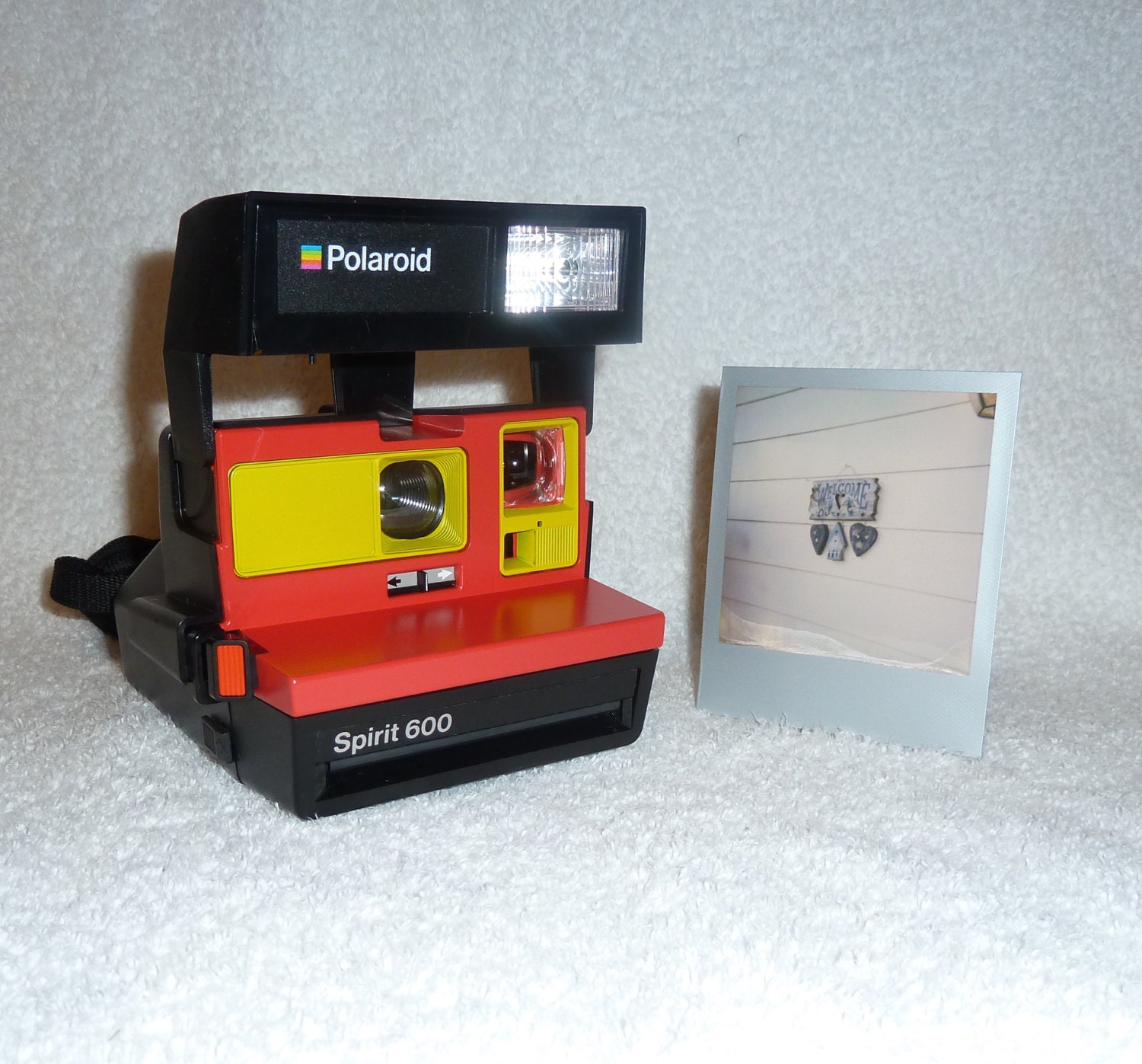 spirit 600 polaroid camera upcycled with red and yellow. Black Bedroom Furniture Sets. Home Design Ideas