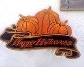 Carved Halloween sign. HAPPY HALLOWEEN with pumpkins
