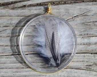 Black and white feather suncatcher