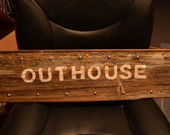 """Rustic barn wood OUTHOUSE sign, measuring 7 1/2"""" h x 26"""" long"""