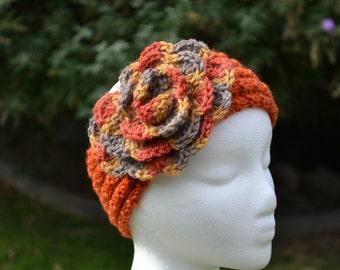 Knitted earwarmer with crochet flower