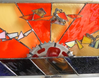 Sunset with bike gears stained glass panel