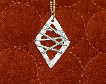 Diamond shaped pure silver .999 pendant with lattice detail on sterling silver chain