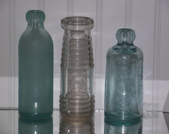 A collection of 3 vintage soda/beverage  bottles in good vintage condition:Taylor, Stockton & EZE