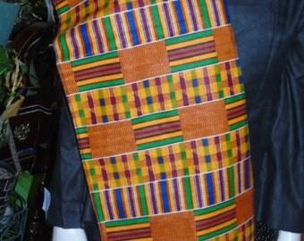 Kente Cloth Sash with.black tassels on each end.
