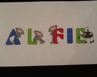 Lovely completed Boys Spaceman Cross Stitch Name Sampler