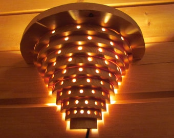 Wall lamp made of nordic pine rings 3