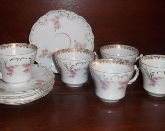 Tea Cups and Saucers with a Pink Rose Pattern with Gold Trim.