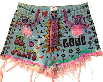 """shorts; upcycled denim, hand painted, high-waisted, bedazzled """"luv bug!""""  wearable art. exclusively by artfink."""
