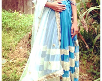 Blue net lehenga with seuin trim and gold sequin choli
