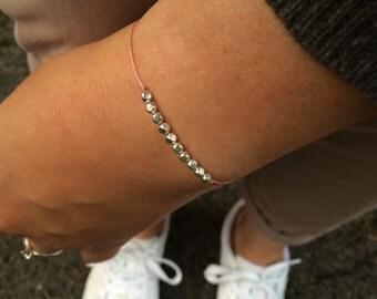 Handmade little friendship bracelet with silver beads