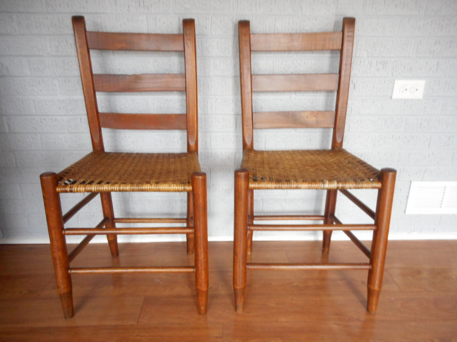 Pair Of Antique Oak Cane Bottom Chairs W/ By MonkeyfootJunction. Full resolution  image, nominally Width 1500 Height 1125 pixels, image with #AF4F1A.
