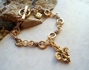 Gold Fleur De Lis Charm Bracelet, Handmade Metal Chain and Toggle plated in 24 Karat Gold.  Handmade.