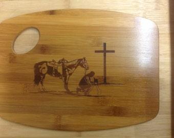 Laser engraved praying cowboy cutting board