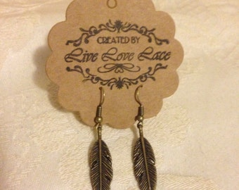 Antique bronze coloured feather earrings