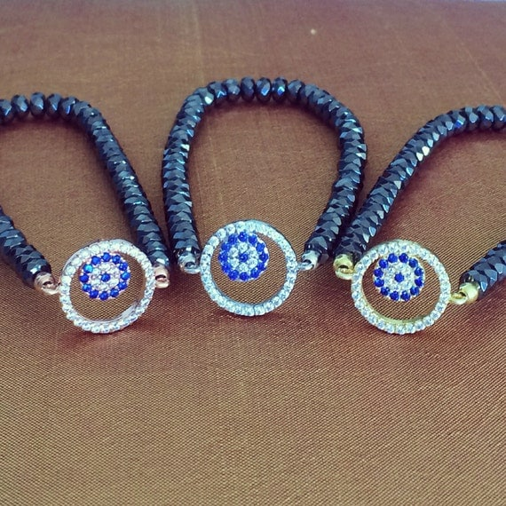 Hematite evil eye stretch bracelet with hematite stones and zirconia super chic and ALWAYS LOW PRICE