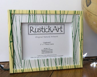 5x7 yellow and white painted picture frame made from clapboard and 2x4 scraps