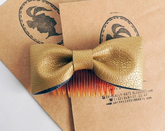 Golden faux leather bow comb for hair