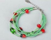 Green beaded  bracelet with ladybugs