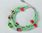 Green beaded  bracelet with ladybugs