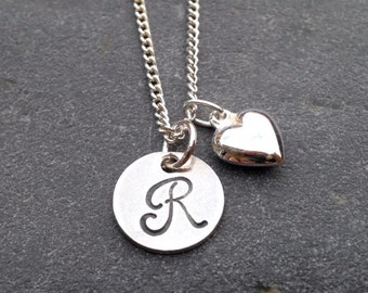 Handstamped personalised Sterling Silver Initial disc pendant, with puff heart on a sterling silver necklace.