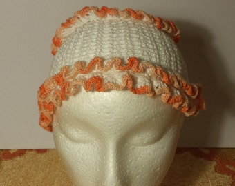 Knitted hat.