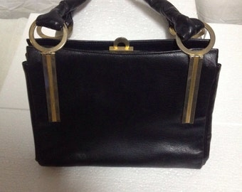 black leather bag 50 years
