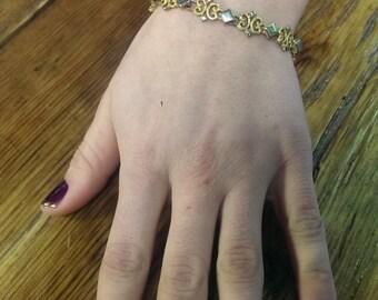Avon gold and silver bracelet