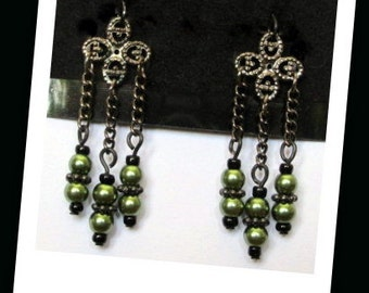 "Green and black glass bead dangle earrings with gunmetal chains and ornate openwork charms, 1.75"" length"