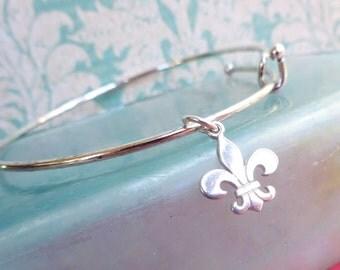 Bangle bracelet with Fleur De Lys charm, Fleur de lis, saints, new orleans, stacking bracelet, layer bracelet, bangle charm bracelet