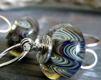 Boro glass bead earrings. Artisan handmade in sterling silver. Plum amber waves. Subtle purple tan swirls. Classic jewelry. Sultry Dance.