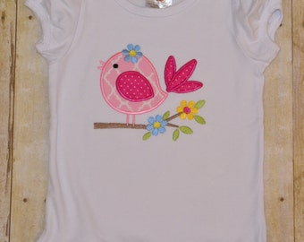 Sweet bird on a branch appliqué ruffle shirt.