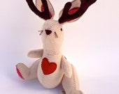Lucky jackrabbit made with wool felt, button joints and completely hand sewn.