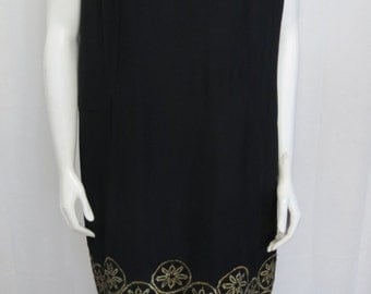 1960's black crepe dress with a sparkle gold tulle bottom overlay size L