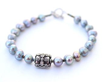 Her Pearl Bracelet