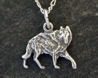 Sterling Silver Wolf Pendant on a Sterling Silver Chain.