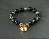 Black and gold Murano glass bracelet. Black and gold beadaed bracelet. Gold charm bracelet. Murano glass jewellery.