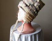 Bliss Pipe - Autumn Sands.  Tall textured crochet hat in cream and brown blends, with ear flaps.