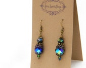 Deep, dark iridescent blue glass bead earrings with filigree - special holiday price!  gifts under 10