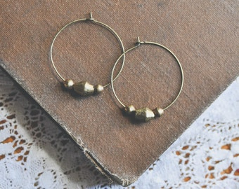 African brass beaded hoop earrings.
