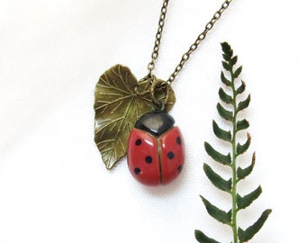 Pottery Ladybug Pendant / Ceramic Ladybird Spring Accessory / Antique Brass Leaf Necklace / Pottery Jewelry / Ladybug Lover Gifts Under 20