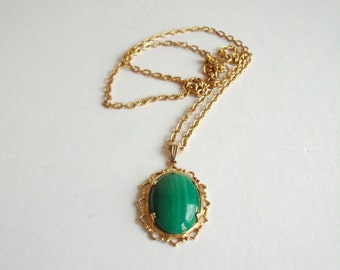 Vintage Malachite Cameo: Green Piece vintage malachite oval stone cameo on a gold tone chain