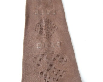Vintage 1970s mens tan brown suede tie with pierced and woven design.