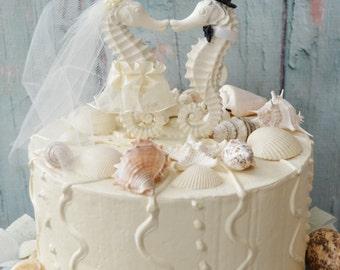Seahorse wedding cake topper-ivory seahorse-beach wedding-beach theme-destination wedding-seahorse bride and groom-kissing seahorse-nautical