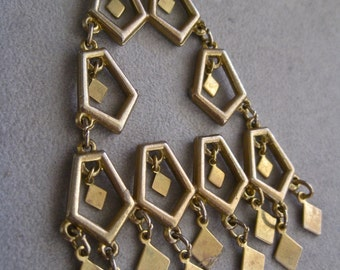 Lisner Modernist Necklace Oversized Statement Pendant on Extra Long Chain Vintage 70s Tribal Geometric Mod Gold Tone Dangles Diamond Shapes