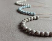 Handmade ceramic light blue, white or gray short strand necklace - beadwork on a short leather cord