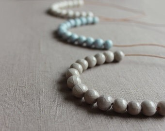 Handmade ceramic light blue, white or gray short strand necklace - beadwork on a short leather cord