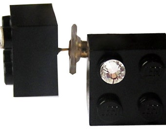 Black LEGO (R) brick 2x2 with a Diamond color SWAROVSKI crystal on a Silver/Gold plated stud